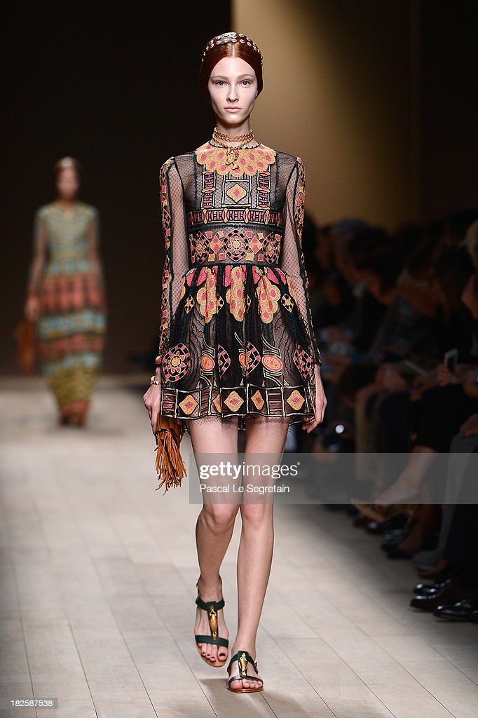 A model walks the runway during Valentino show as part of the Paris Fashion Week Womenswear Spring/Summer 2014 at Espace Ephemere Tuileries on October 1, 2013 in Paris, France.