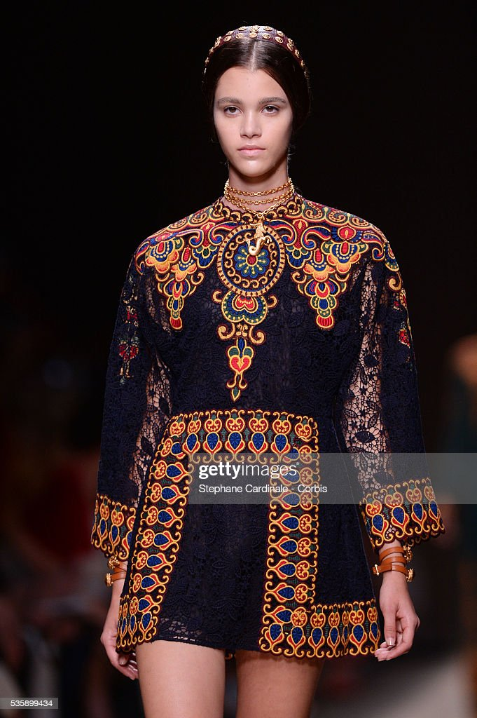 A model walks the runway during Valentino show, as part of the Paris Fashion Week Womenswear Spring/Summer 2014, in Paris.