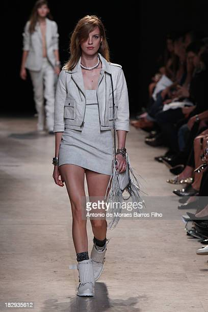 A model walks the runway during Zadig Voltaire show as part of the Paris Fashion Week Womenswear Spring/Summer 2014 on October 2 2013 in Paris France
