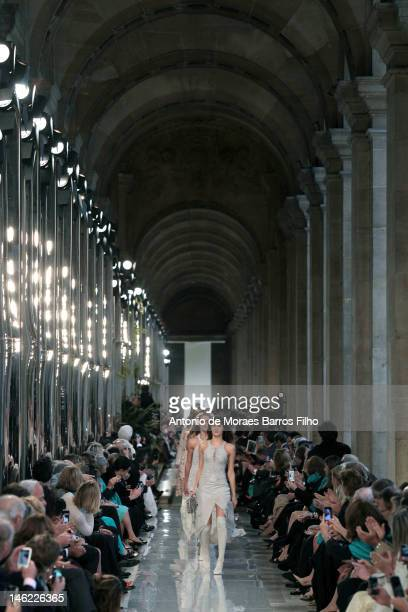 A model walks the runway duringSalvatore Ferragamo Cruise Collection 2013 Show at Galerie Denon on June 12 2012 in Paris France