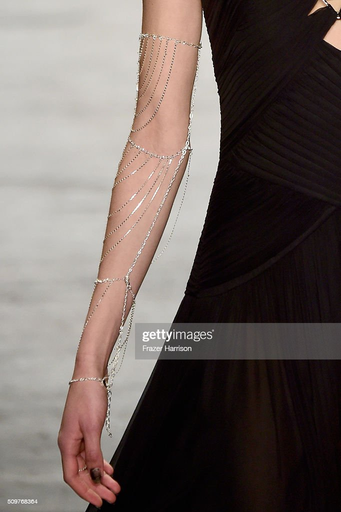 A model walks the runway, fashion detail, wearing Tadashi Shoji Fall 2016 during New York Fashion Week: The Shows at The Arc, Skylight at Moynihan Station on February 12, 2016 in New York City.