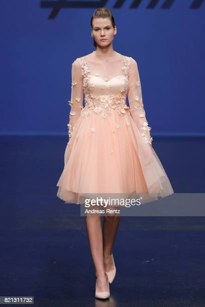 A model walks the runway for '7slim' at the PF Selected show during Platform Fashion July 2017 at Areal Boehler on July 23 2017 in Duesseldorf Germany