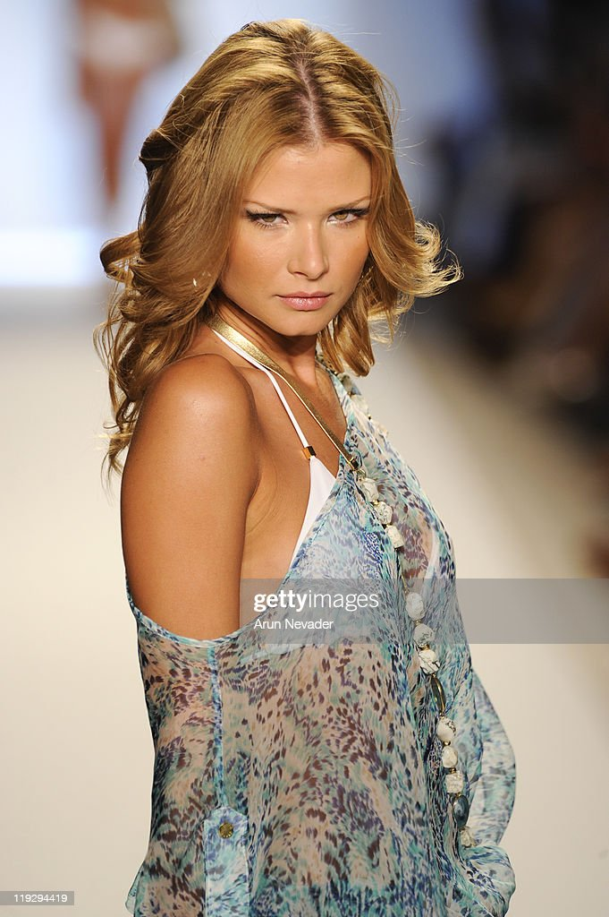 Model walks the runway for Caffe Swimwear during MercedesBenz Fashion Week Swim at The Raleigh on July 16 2011 in Miami Beach Florida