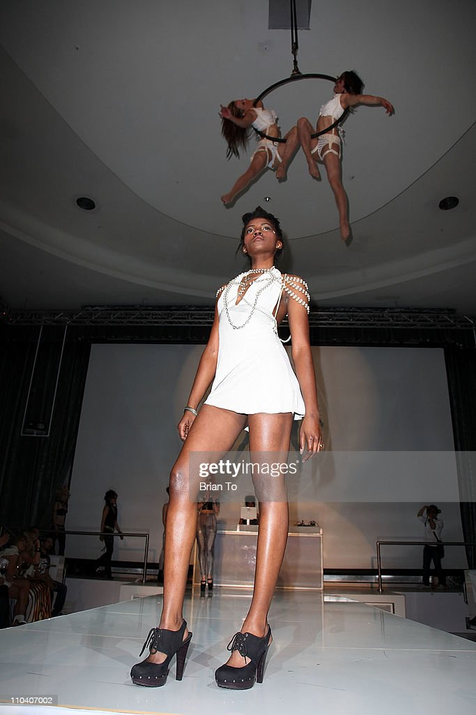 A model walks the runway for Made in LA presents 'Bebe: The After Party' for Los Angeles fashion week spring 2011 at SupperClub Los Angeles on March 17, 2011 in Los Angeles, California.