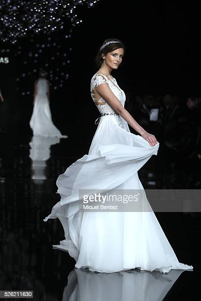 A model walks the runway for Pronovias bridal collection during the 'Barcelona Bridal Fashion Week 2016' at Italian Pavilion of Fira Barcelona on...