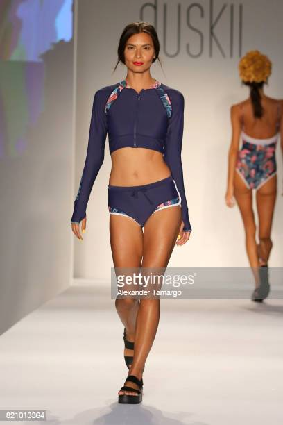 A model walks the runway for SWIMMIAMI Duskii 2018 Collection at SWIMMIAMI tent on July 22 2017 in Miami Beach Florida
