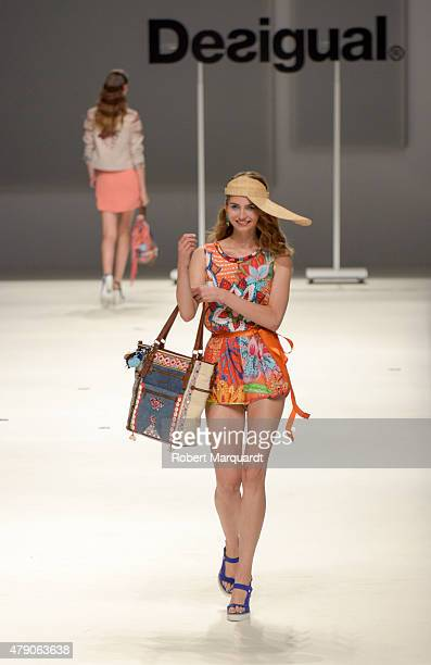 A model walks the runway for the Desigual fashion show at 'Barcelona 080 Fashion AutumnWinter 20152016' on June 30 2015 in Barcelona Spain