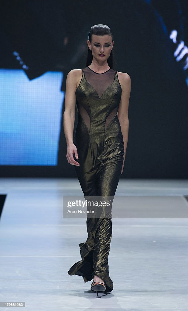 A model walks the runway for the JM Couture fashion show during El Paseo Fashion Week 2014 on March 20, 2014 in Palm Desert, California.