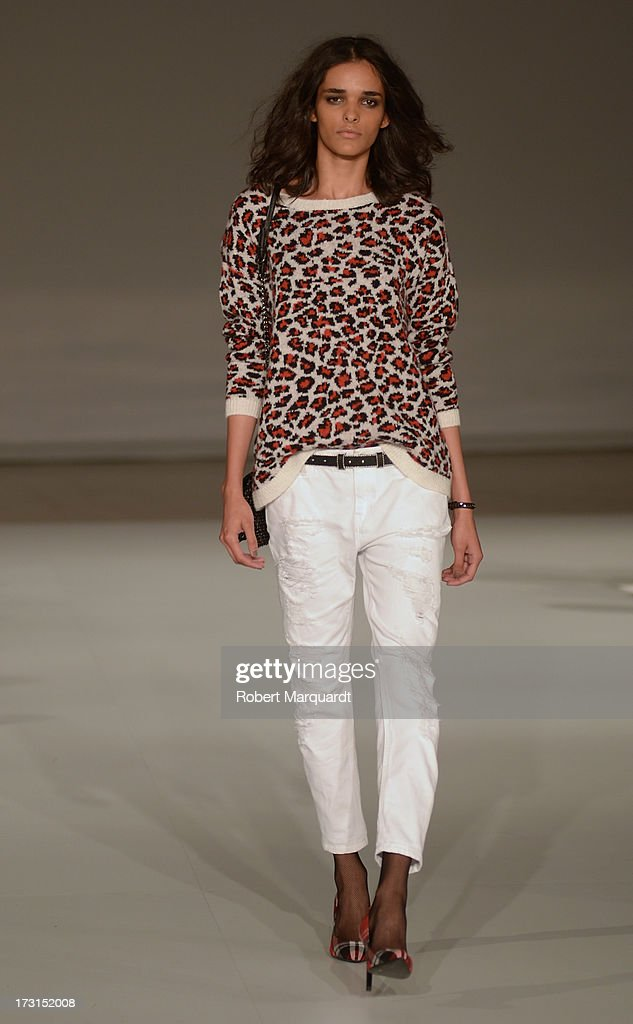A model walks the runway for the latest collection by MANGO held at the Disseny Hub Barcelona on July 8, 2013 in Barcelona, Spain.