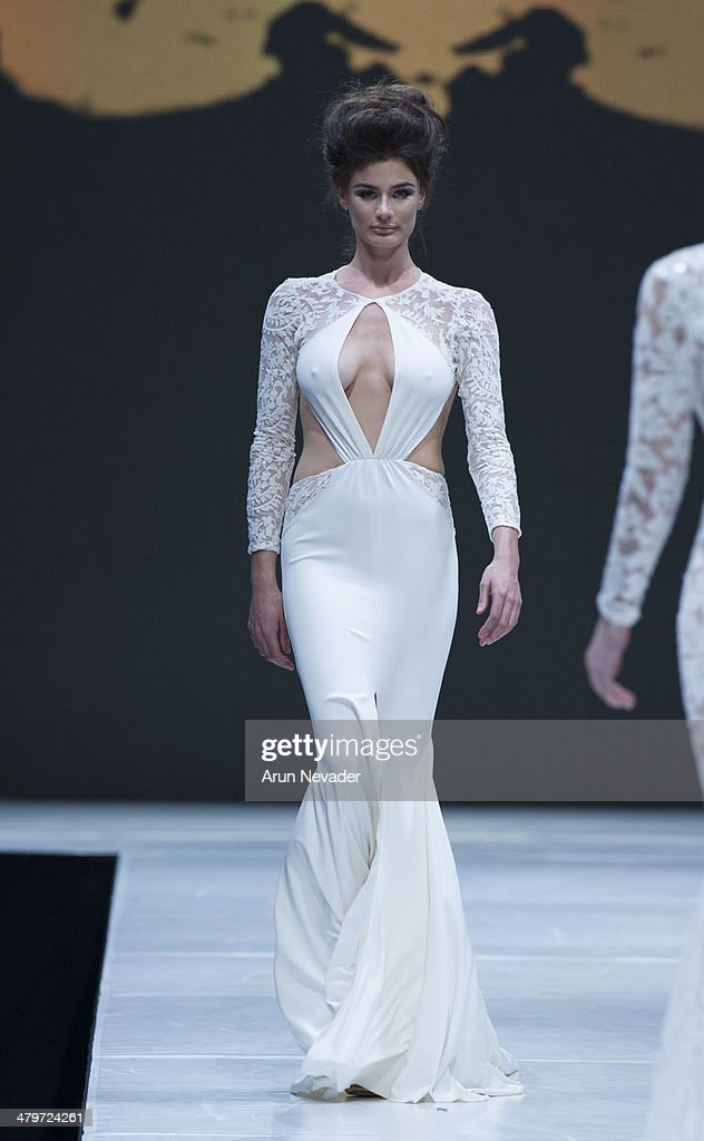 A model walks the runway for the Michael Costello Couture fashion show fall 2014 during Project Runway at El Paseo Fashion Week 2014 on March 19, 2014 in Palm Desert, California.
