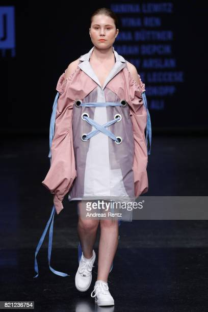 A model walks the runway for the 'Project Upcycling' show during the AMD Exit17_2 show during Platform Fashion July 2017 at Areal Boehler on July 23...