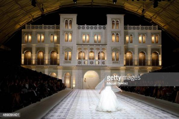 A model walks the runway for the Pronovia's 50th anniversary bridal fashion show during 'Barcelona Bridal Week 2014' on May 9 2014 in Barcelona Spain