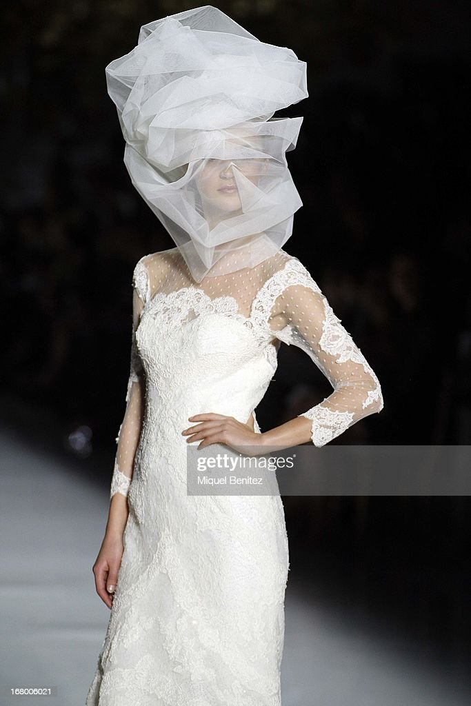 A model walks the runway for the Pronovias bridal fashion show during Barcelona Bridal Week 2013 on May 3, 2013 in Barcelona, Spain.