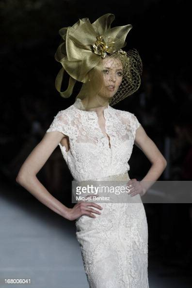 A model walks the runway for the Pronovias bridal fashion show during Barcelona Bridal Week 2013 on May 3 2013 in Barcelona Spain