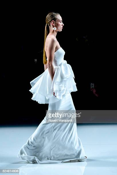 A model walks the runway for the 'Rosa Clara' bridal collection on April 26 2016 in Barcelona Spain