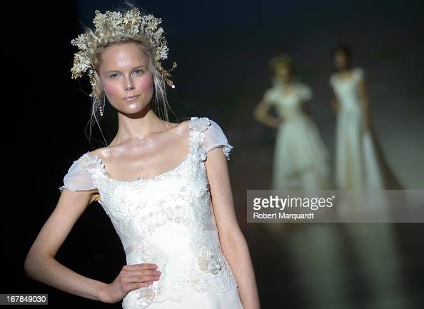 A model walks the runway for the Victorio and Lucchino bridal collection at Barcelona Bridal Week 2013 on April 30 2013 in Barcelona Spain