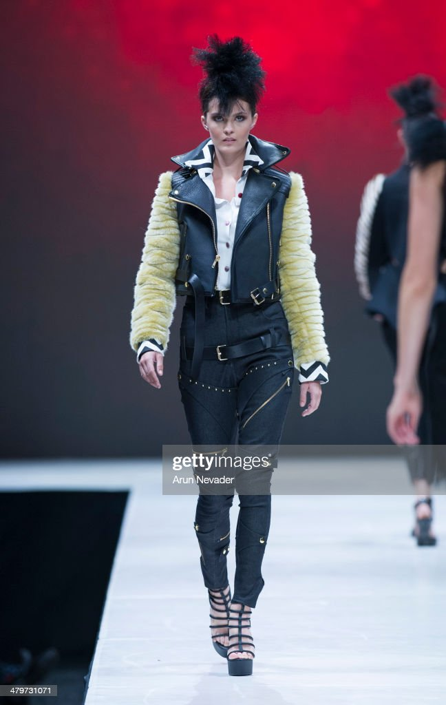 A model walks the runway for the Viktor Luna fashion show during Project Runway at El Paseo Fashion Week 2014 on March 19, 2014 in Palm Desert, California.