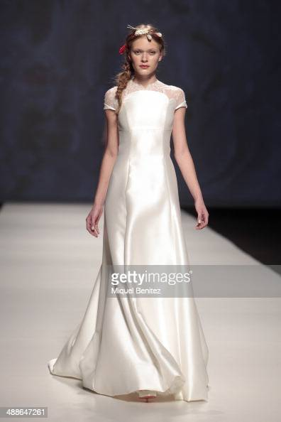 A model walks the runway for the Vitorio Lucchino fashion show during 'Barcelona Bridal Week 2014' on May 7 2014 in Barcelona Spain