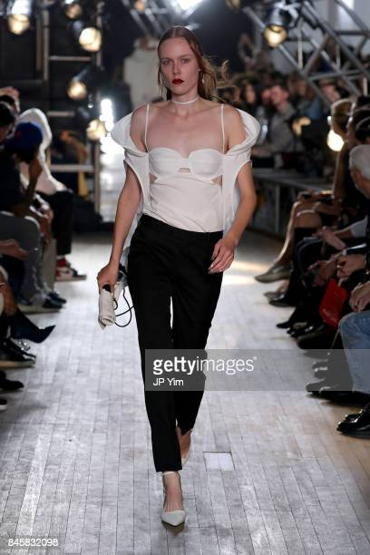 A model walks the runway for TRESemme Helmut Lang Seen By Shayne Oliver fashion show during New York Fashion Week on September 11 2017 in New York...