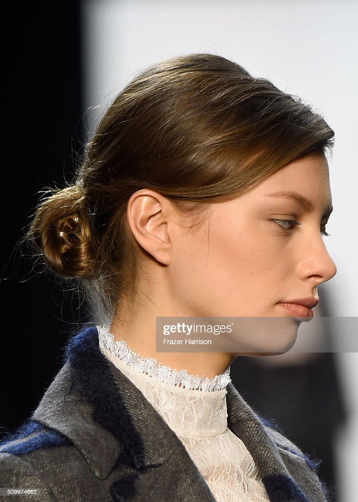 A model walks the runway, hair detail, wearing Taoray Wang Fall 2016 during New York Fashion Week: The Shows at The Dock, Skylight at Moynihan Station on February 13, 2016 in New York City.