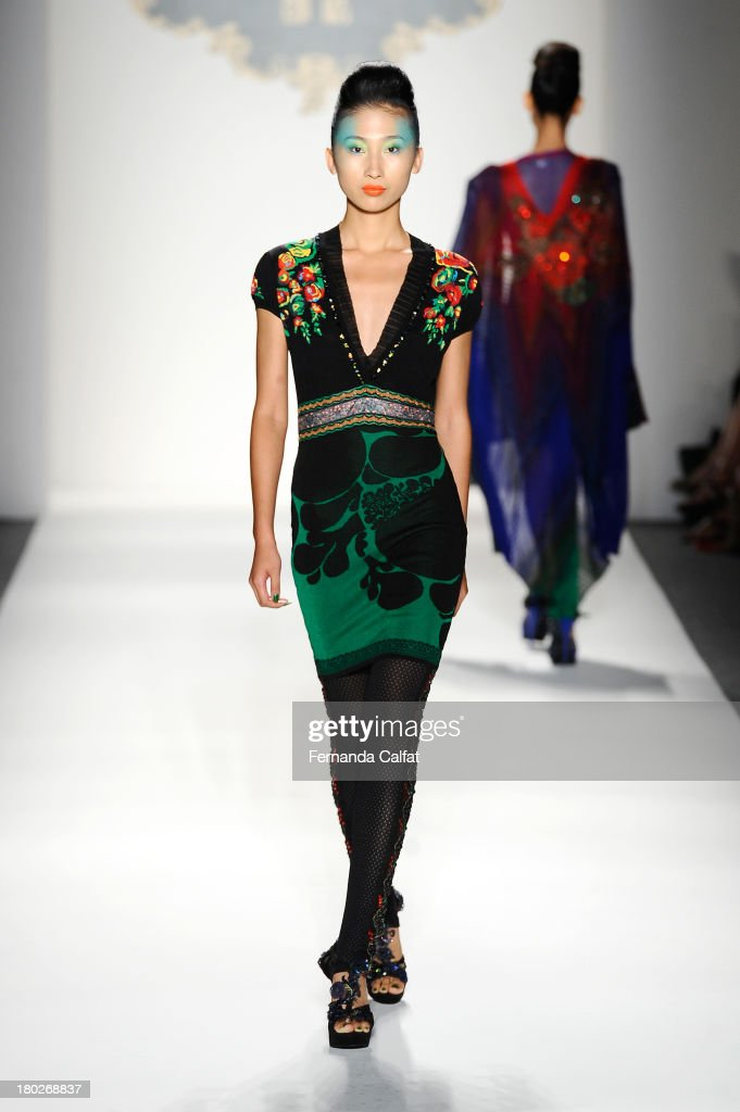 A model walks the runway in a Deng Hao design at the Fashion Shenzhen fashion show during Mercedes-Benz Fashion Week Spring 2014 at The Studio at Lincoln Center on September 10, 2013 in New York City.