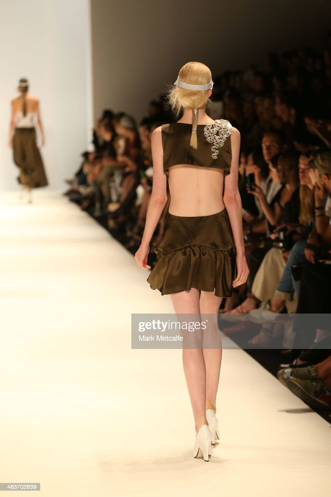 A model walks the runway in a design by Bei Na Wei at The Innovators show during Mercedes-Benz Fashion Week Australia 2014 at Carriageworks on April 10, 2014 in Sydney, Australia.