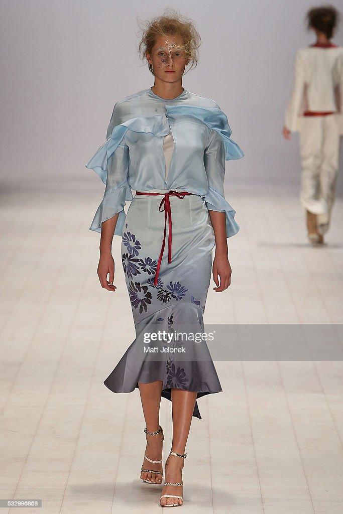 A model walks the runway in a design by Gemma Saccasan at the Raffles International Showcase show at MercedesBenz Fashion Week Resort 17 Collections...