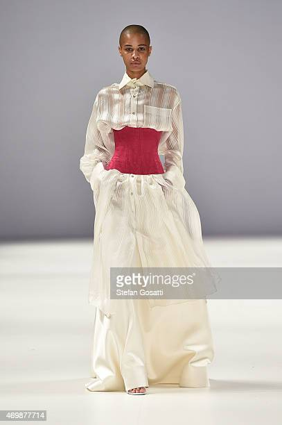 A model walks the runway in a design by Iven Teh at the Raffles International Showcase show at MercedesBenz Fashion Week Australia 2015 at...