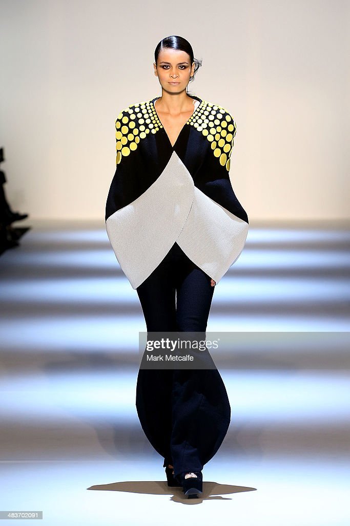 A model walks the runway in a design by Logvin Code at The Innovators show during Mercedes-Benz Fashion Week Australia 2014 at Carriageworks on April 10, 2014 in Sydney, Australia.