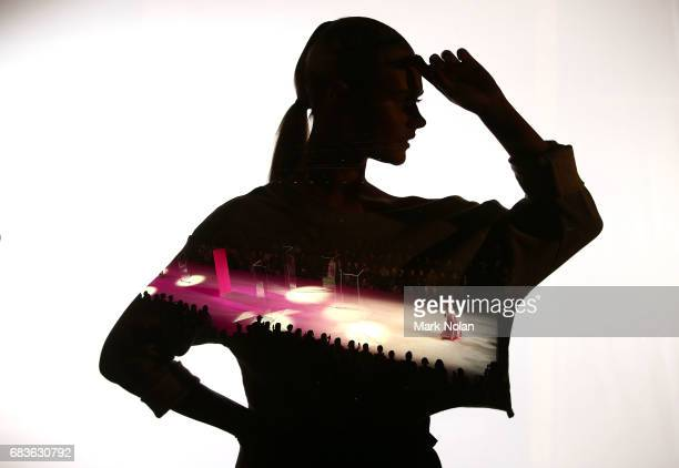 A model walks the runway in a design by Michael Lo Sordo and a model poses during the Michael Lo Sordo show at MercedesBenz Fashion Week Resort 18...