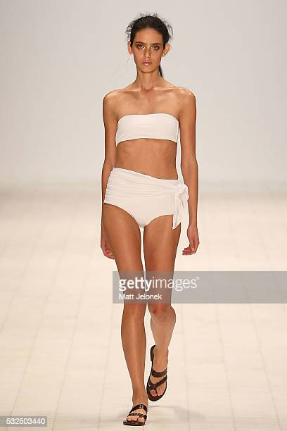 A model walks the runway in a design by Palm Swim Resort at the Swim show at MercedesBenz Fashion Week Resort 17 Collections at Carriageworks on May...
