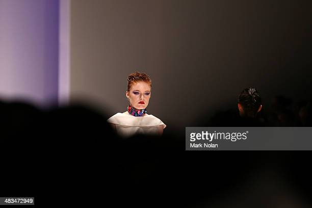 A model walks the runway in a design by Paul Nathaphol at the Raffles during MercedesBenz Fashion Week Australia 2014 at Carriageworks on April 9...