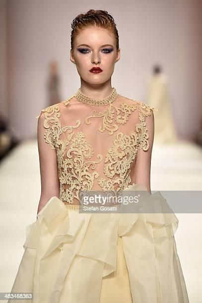 A model walks the runway in a design by Sara Aljaism at the Raffles show during MercedesBenz Fashion Week Australia 2014 at Carriageworks on April 9...