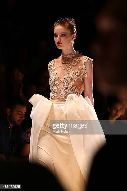 A model walks the runway in a design by Sara Aljaism at the Raffles during MercedesBenz Fashion Week Australia 2014 at Carriageworks on April 9 2014...