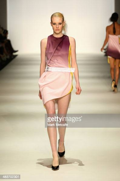 A model walks the runway in a design by Yousef Akbar at The Innovators show during MercedesBenz Fashion Week Australia 2014 at Carriageworks on April...