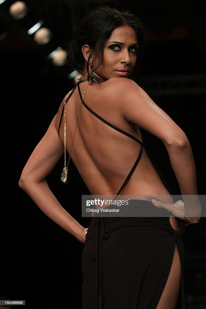 A model walks the runway in a Ganjam Jewellery design at the India International Jewellery Week 2012 Day 1 at the Grand Hyatt on on August 19, 2012 in Mumbai, India.