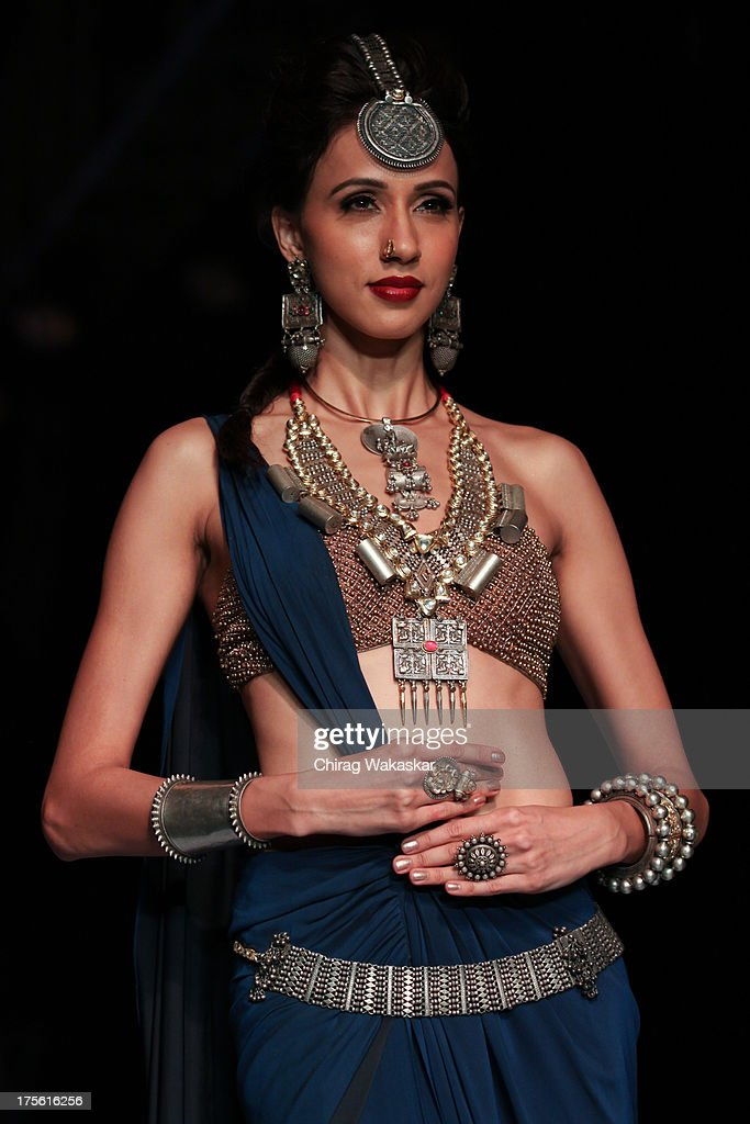 A model walks the runway in an Apala design on day 1 of India International Jewellery Week 2013 at the Hotel Grand Hyatt on August 4, 2013 in Mumbai, India.