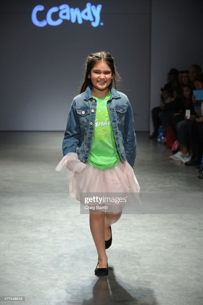 A model walks the runway in CCandy by Amber Sabathia at petitePARADE Kids Fashion Week on March 8, 2014 in New York City.