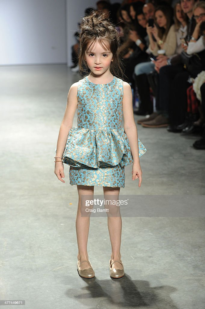 A model walks the runway in fashion by Alivia Simone at petitePARADE Kids Fashion Week on March 8, 2014 in New York City.