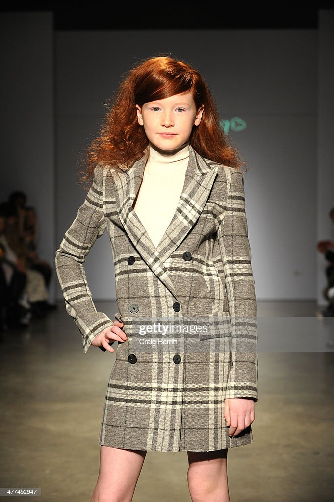 A model walks the runway in fashion by Bonnie Young at petitePARADE Kids Fashion Week on March 8, 2014 in New York City.