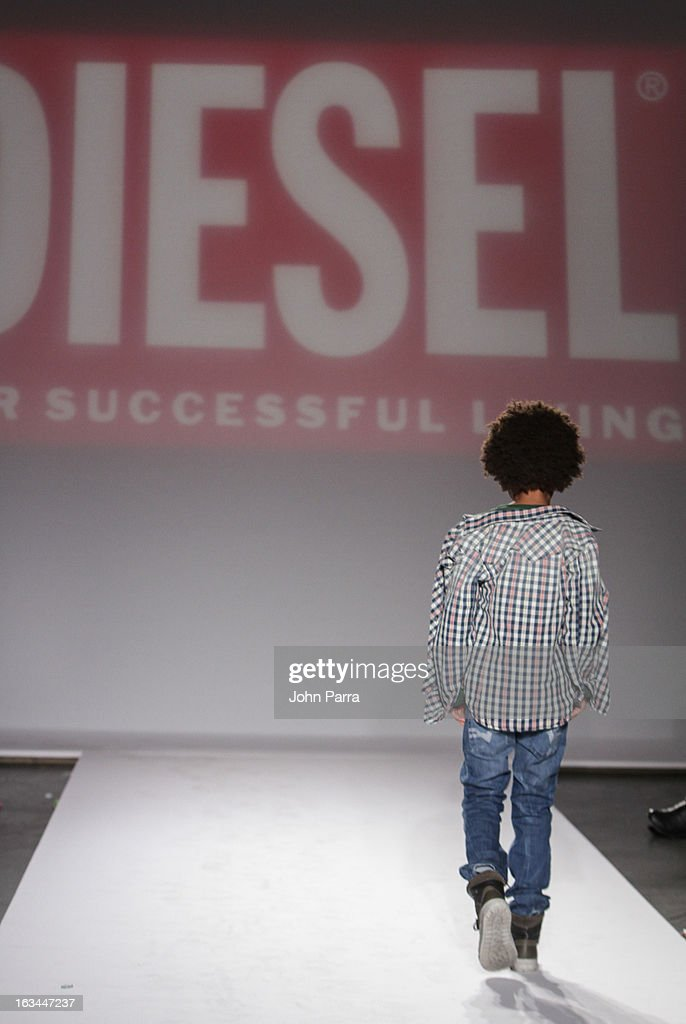 A model walks the runway in the Diesel Kids fashion show during 2013 petitePARADE Kids Fashion Week at Industria Superstudio on March 9, 2013 in New York City.