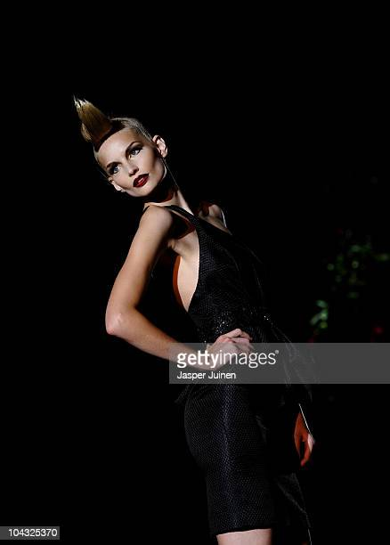 A model walks the runway in the Hannibal Laguna fashion show during the Cibeles Madrid Fashion Week Spring/Summer 2011 at the Ifema on September 21...