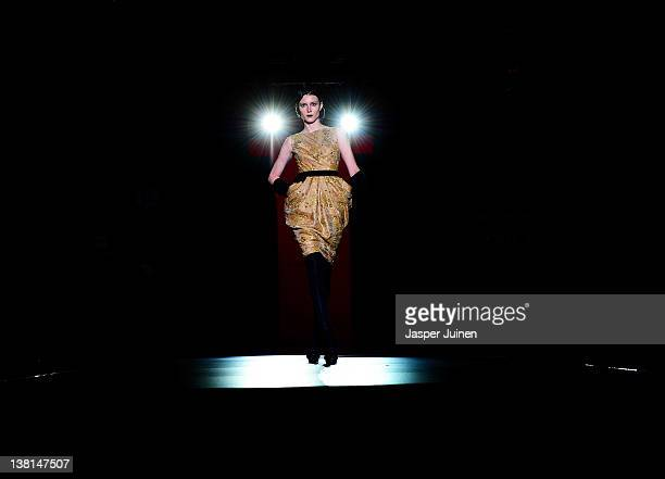 A model walks the runway in the Hannibal Laguna fashion show during the MercedesBenz Fashion Week Madrid Autumn/Winter 2012 at Ifema on February 3...