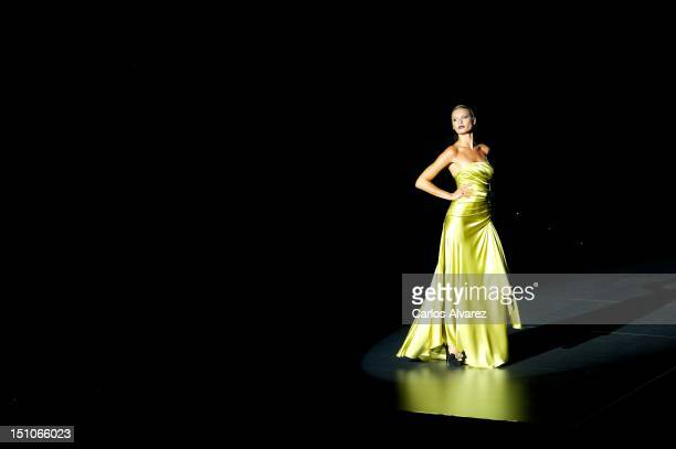 A model walks the runway in the Hannibal Laguna fashion show during the MercedesBenz Fashion Week Madrid Spring/Summer 2013 at Ifema on August 31...