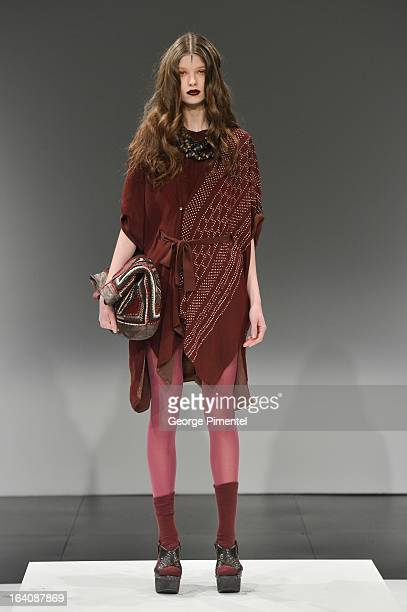 A model walks the runway in the Laura Siegel Fall 2013 collection at David Pecaut Square on March 19 2013 in Toronto Canada