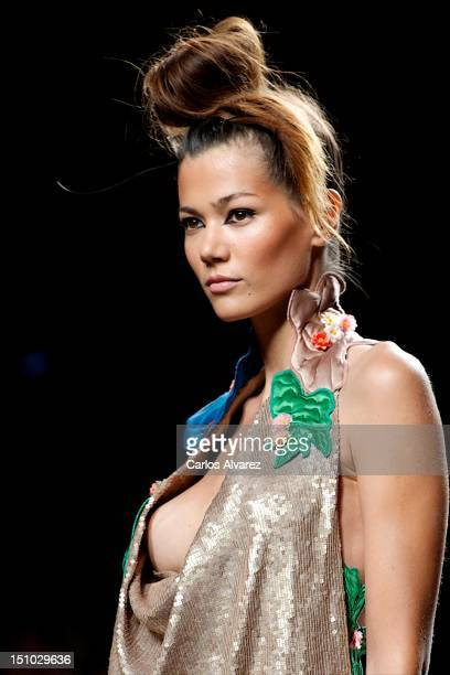 A model walks the runway in the Victorio Lucchino fashion show during the MercedesBenz Fashion Week Madrid Spring/Summer 2013 at Ifema on August 31...