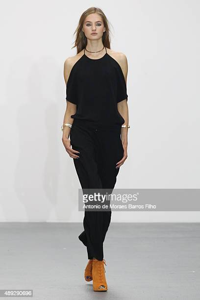 A model walks the runway of the Issa show during London Fashion Week Spring/Summer 2016/17 on September 20 2015 in London England