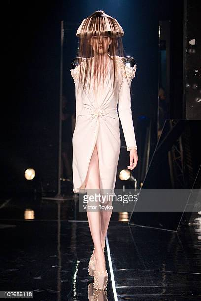 A model walks the runway of the Jan Taminiau show as part of Paris Fashion Week Fall/Winter 2011 at BETC EURO RSCG on July 7 2010 in Paris France