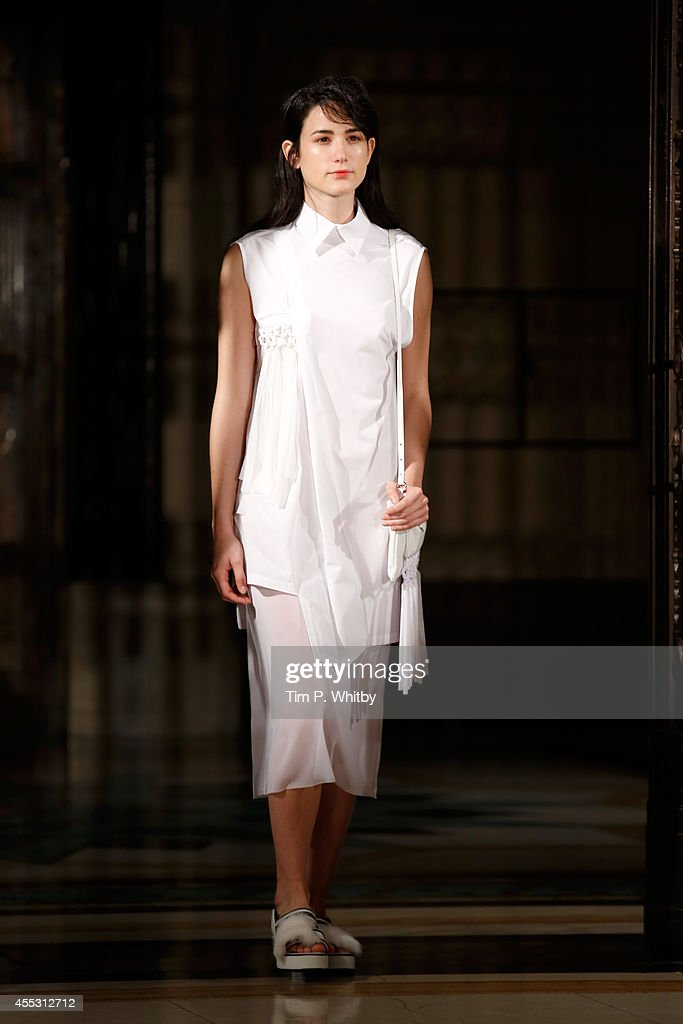 A model walks the runway of the Ming presentation during London Fashion Week Spring Summer 2015 at Fashion Scout Venue on September 12 2014 in London...