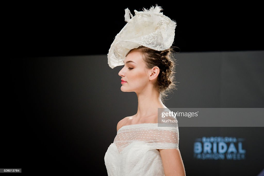 A model walks the runway presenting a wedding dress during the Cymbeline catwalk show at the Bridal Fashion Week in Barcelona (Spain) on 29 April, 2016.